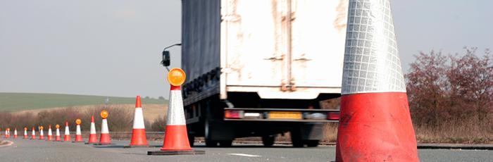 Truck driving past pylons