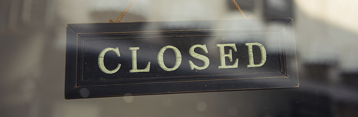 Close up of closed shop sign