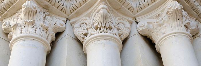 three ornate pillars supporting a building