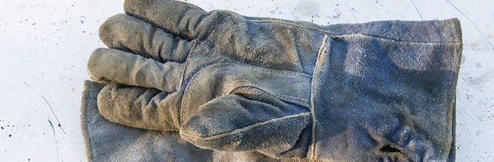 A pair of heavily used work gloves