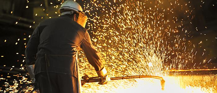 Welder working with hot metal