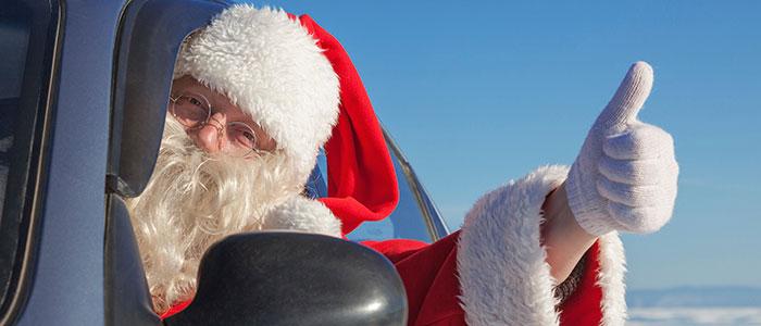 Santa Claus driving a car.
