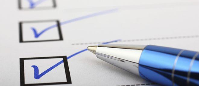 pen checking off a checklist
