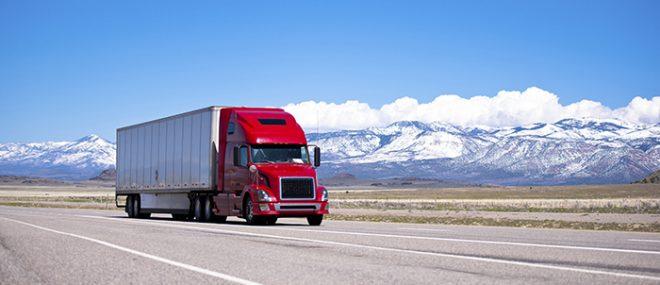truck driving along highway.