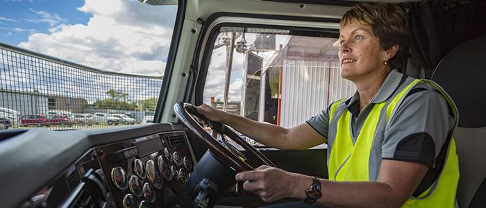 Women driving a transport truck