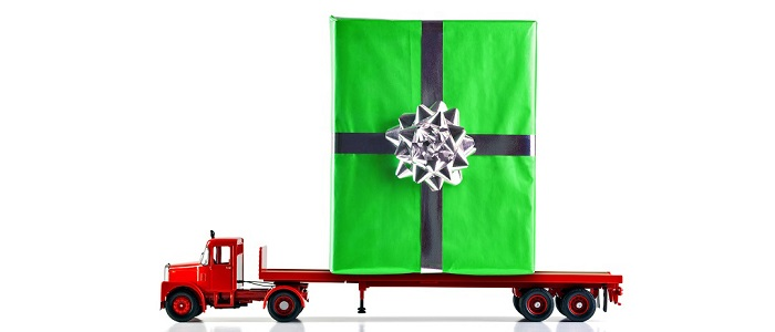 Christmas gift on a flatbed truck.