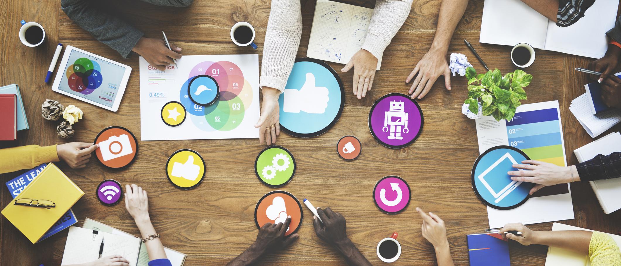 social media symbols on table.