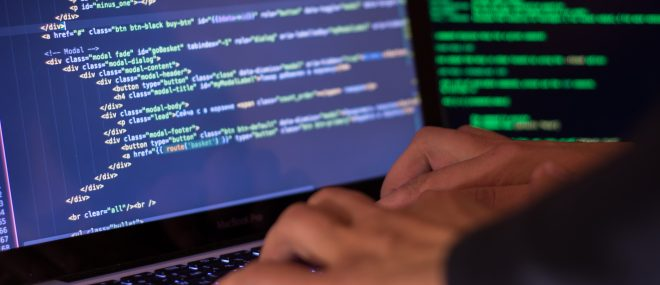 typing on a laptop keyboard to manage cyber risk.