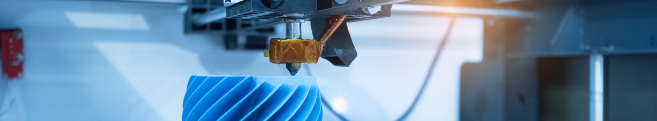 3D printing machine making a plastic device.