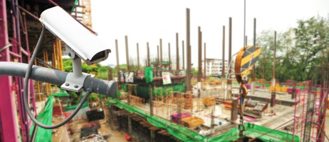 Construction surveillance with video camera mounted on building