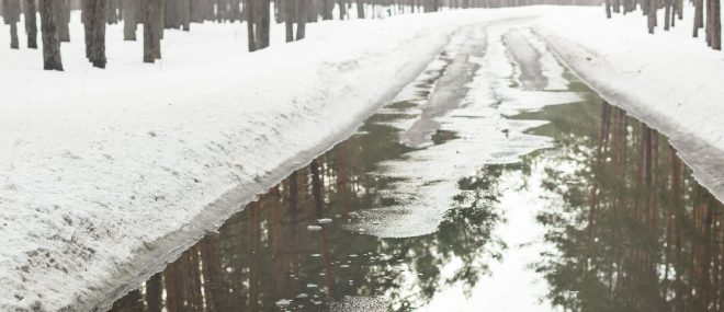 Flooding of road from melting snow