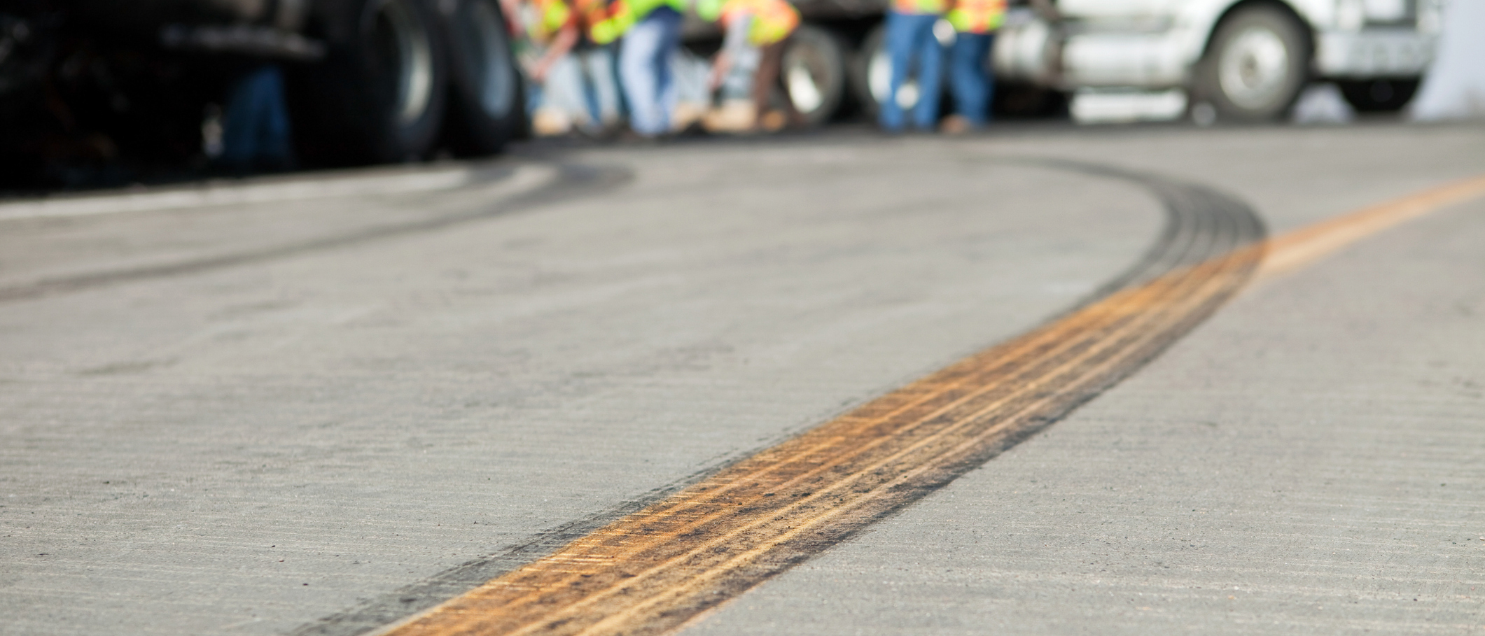skid marks on the road following truck collision