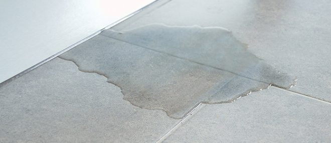 Tiled floor with puddle of water