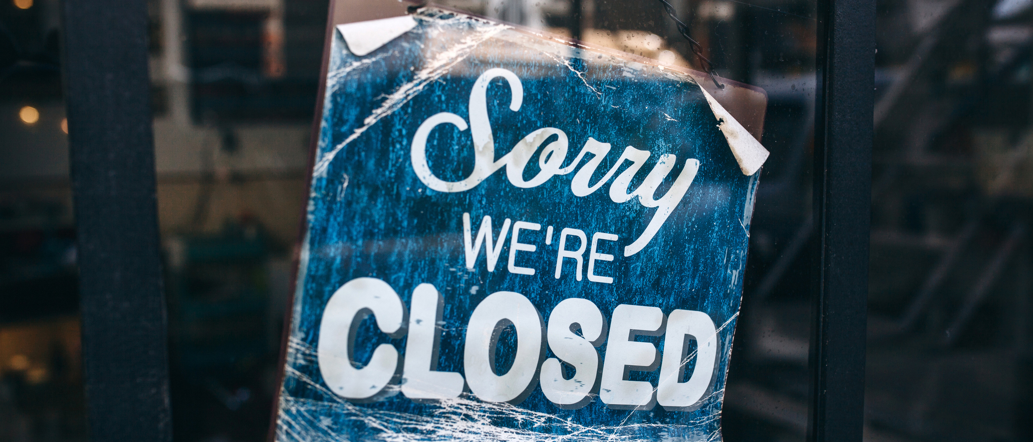 A business closing time sign.