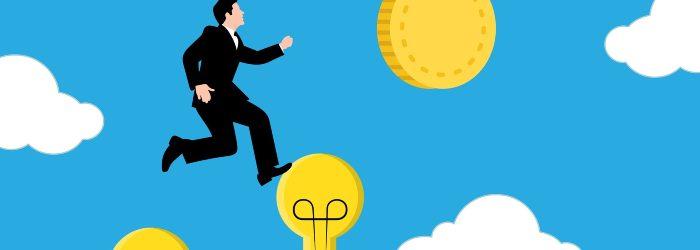 Business man climbing up to reach goal