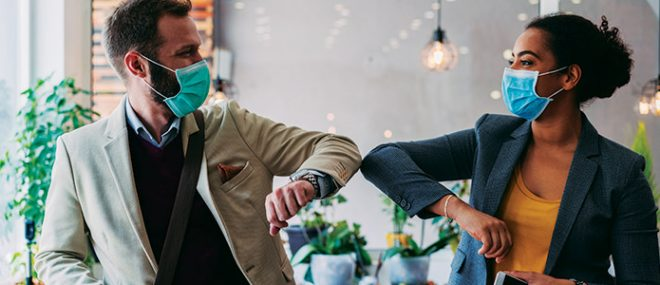 Business people greeting during pandemic with elbow bump