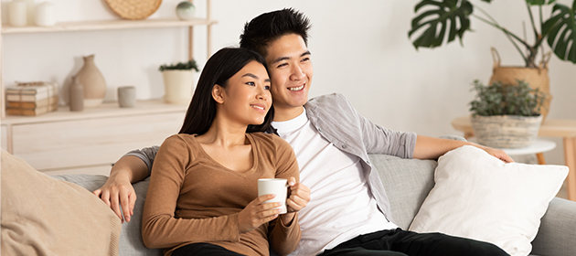 A young couple sitting on a couch.