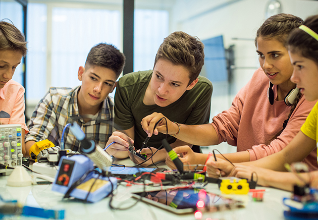 A group of kids learning to work together