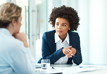 A legal professional having a one-on-one discussion with a client.