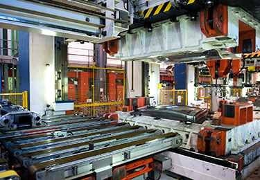 Inactive production machinery in a manufacturing factory.