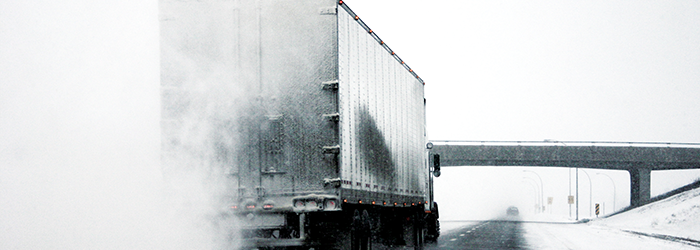 A truck being driven in the snow