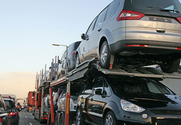 Auto hauler in traffic.