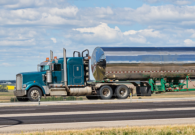 A large haul tanker on a highway