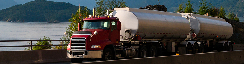 A tanker truck driving on a road.