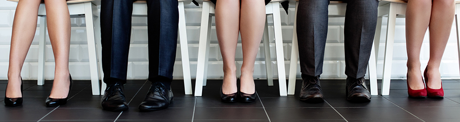Bottom view of people sitting waiting for job interview.