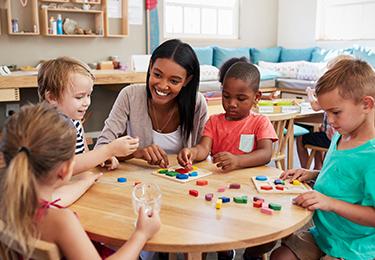 educator smiling at children