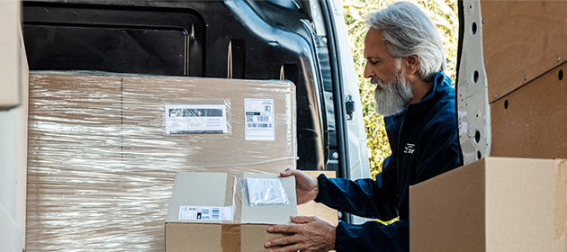 A man unloading a delivery truck.
