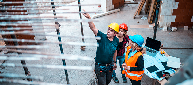 A risk service team member assessing risk on a construction site.
